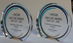 Freestanding circular crystal award with colour printed logo and text